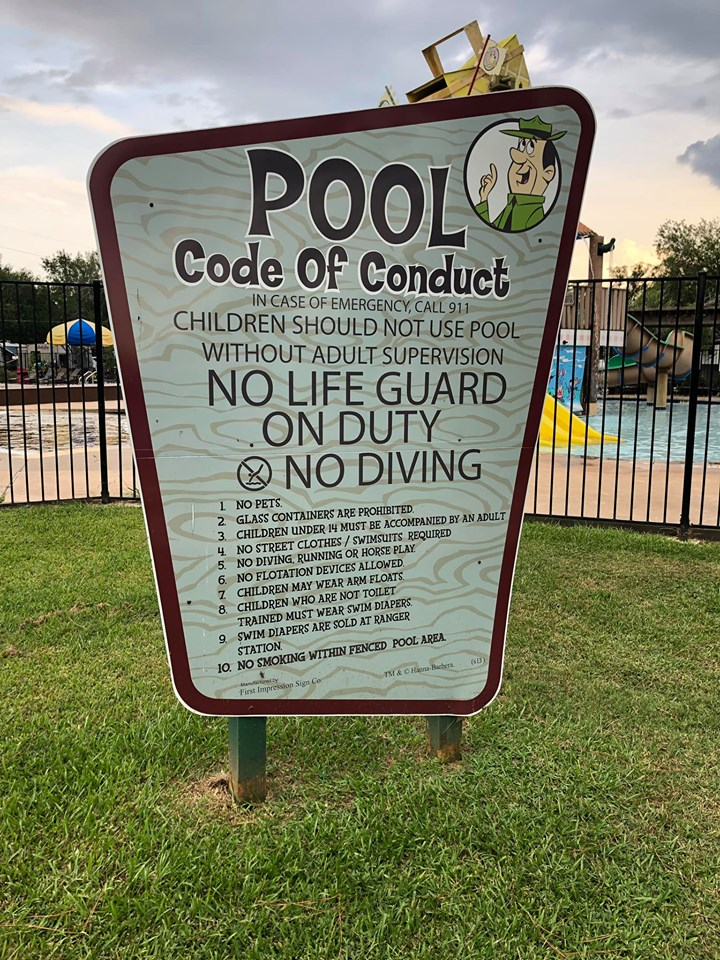 Pool code of conduct sign at Jellystone in Texas.   Jellystone Park in Waller, Texas