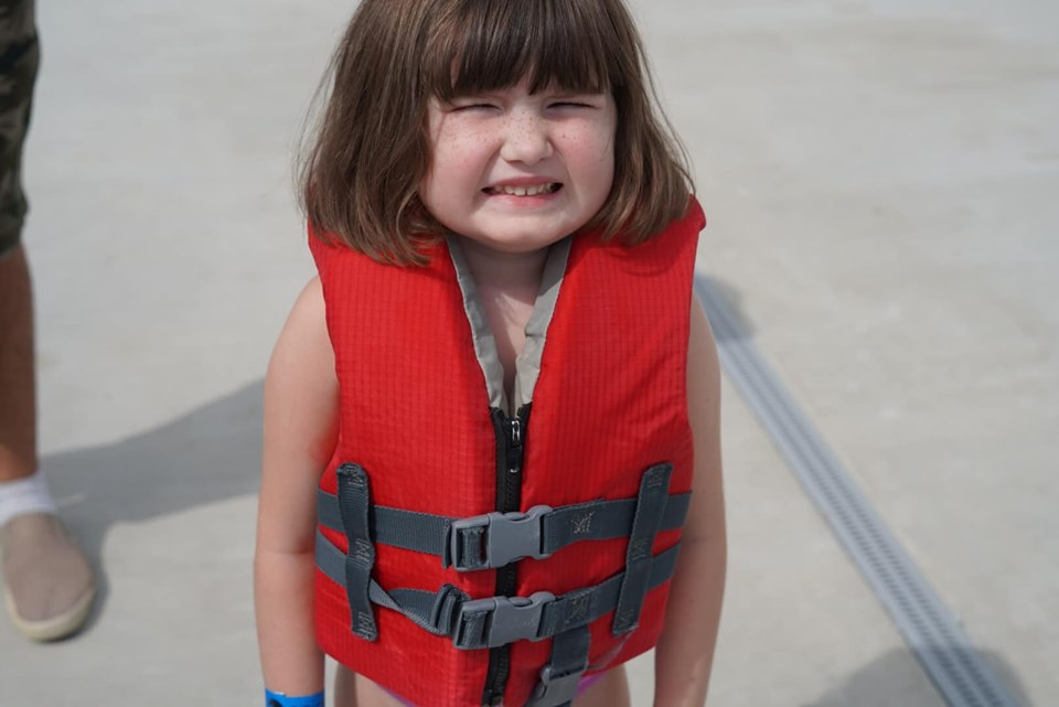 Little girl wearing lifejacket at Epic.| Epic Waterpark in Dallas, Texas