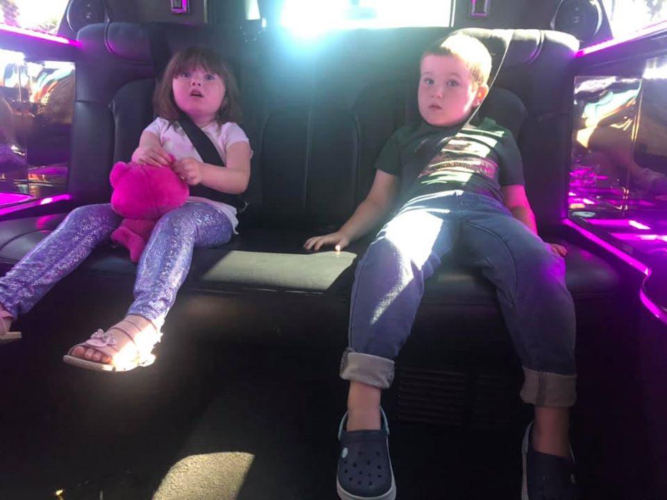 Kids sitting in a limo.   Atlantis, Bahamas