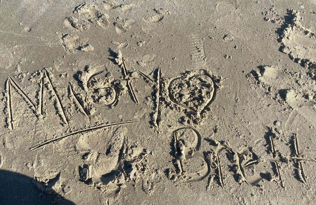 Love note drawn in the sand saying Misty and Brett with a heart. | Lively Beach in Corpus Christi, Texas