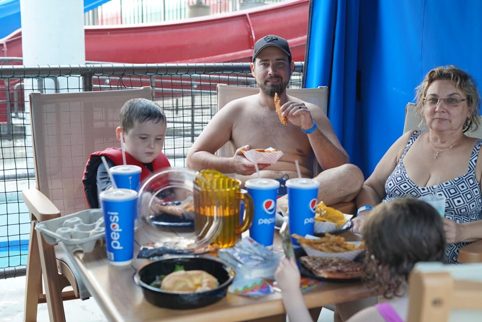 Family eating lunch inside a cabana at Epic.| Epic Waterpark in Dallas, Texas