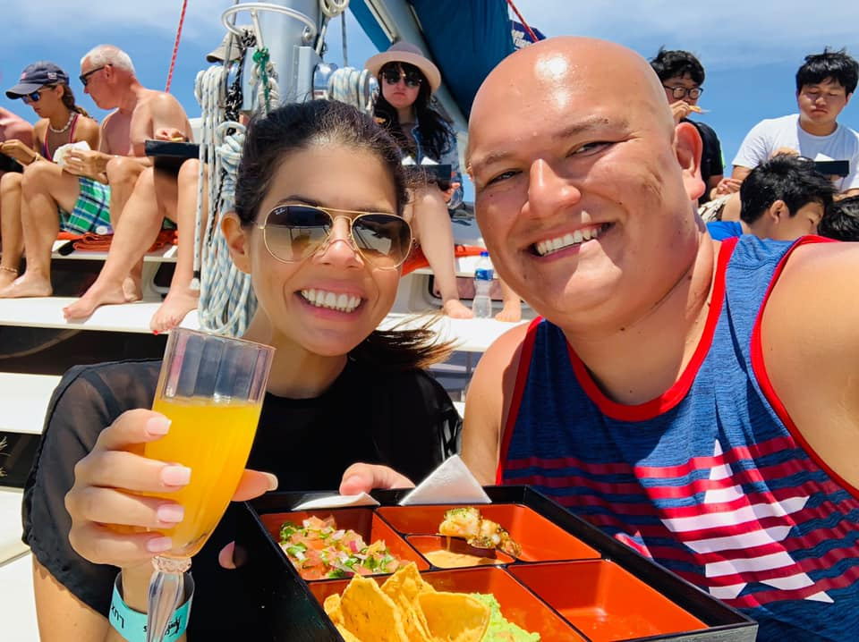 Couple eating and drinking on the boat in Cabo.   Cabo, Mexico- The Best All Inclusive Vacation