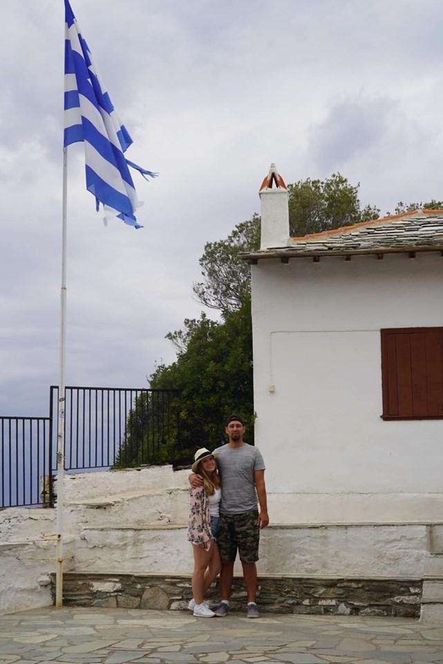 Couple posing in front of the Mamma Mia chapel. | Skopelos Island, Greece- Mamma Mia Island