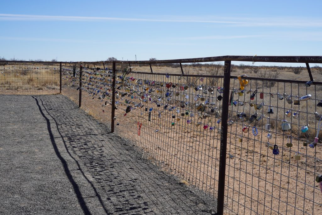 View of love lock gate wall in Marfa. | Marfa, Texas- Where to Stay, What to do, & What to Eat