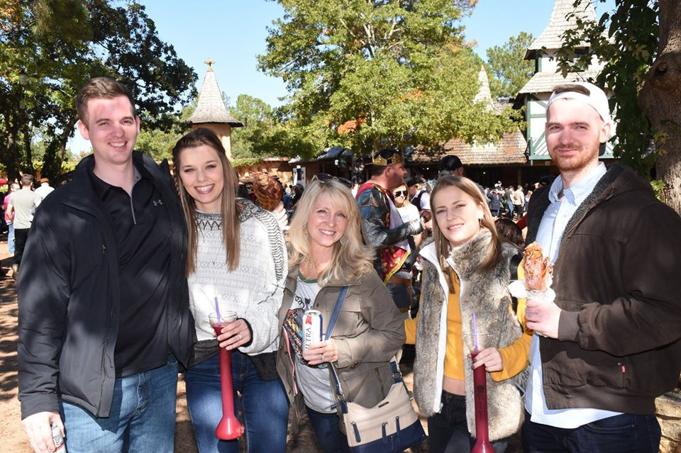 Family posing with drinks and food.| Texas Renaissance Festival