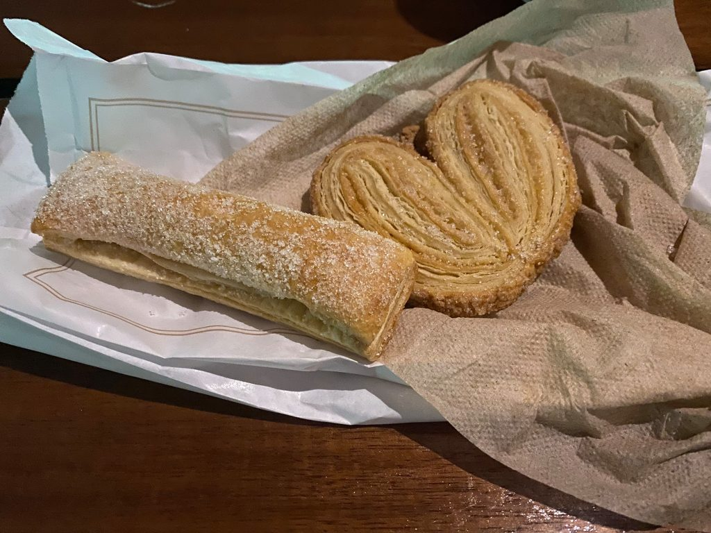 Bag of Mexican pastries with napkin.   A Guide to Xenotes Water Tours by Xcaret