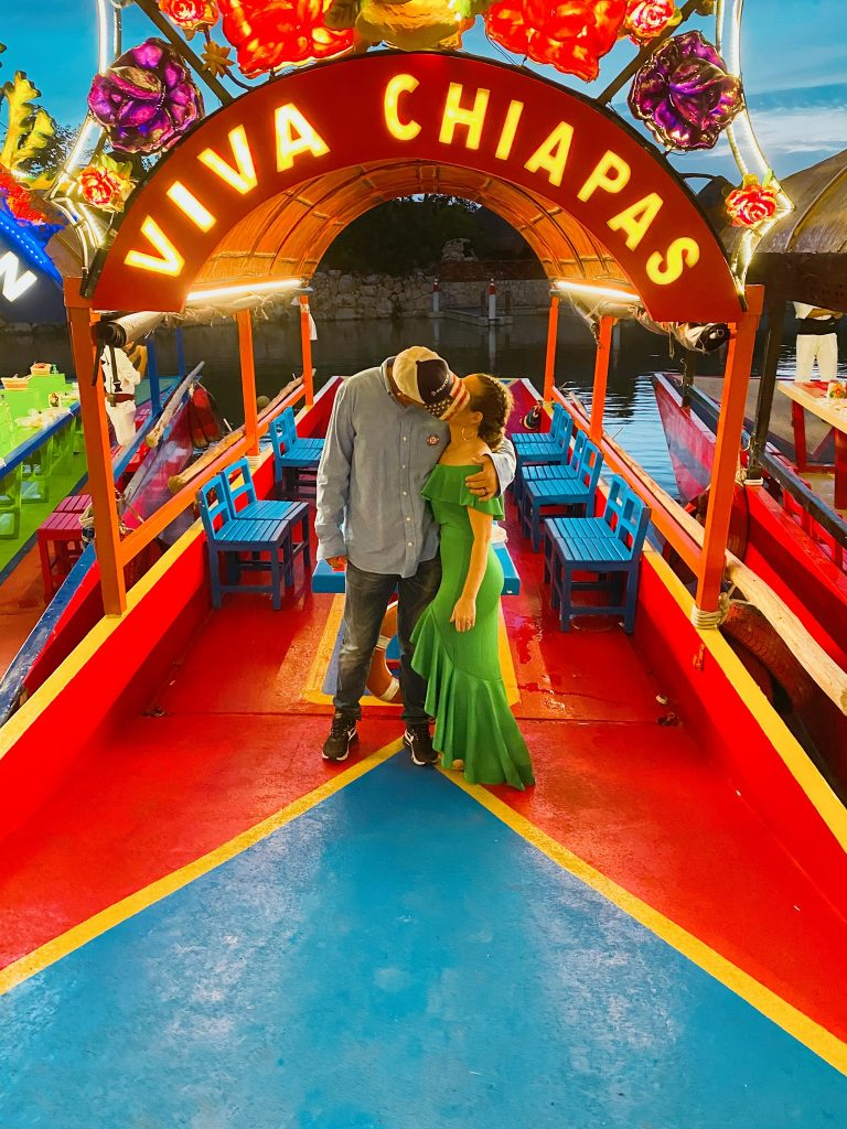 Couple kissing in front of the Viva Chiapas sign in Mexico Park. | XOXIMILCO Cancun, Mexico