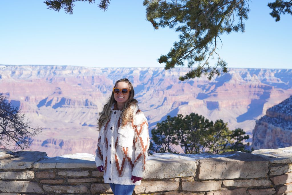Woman posing in front of the Grand Canyon. | Arizona Itinerary with Kids