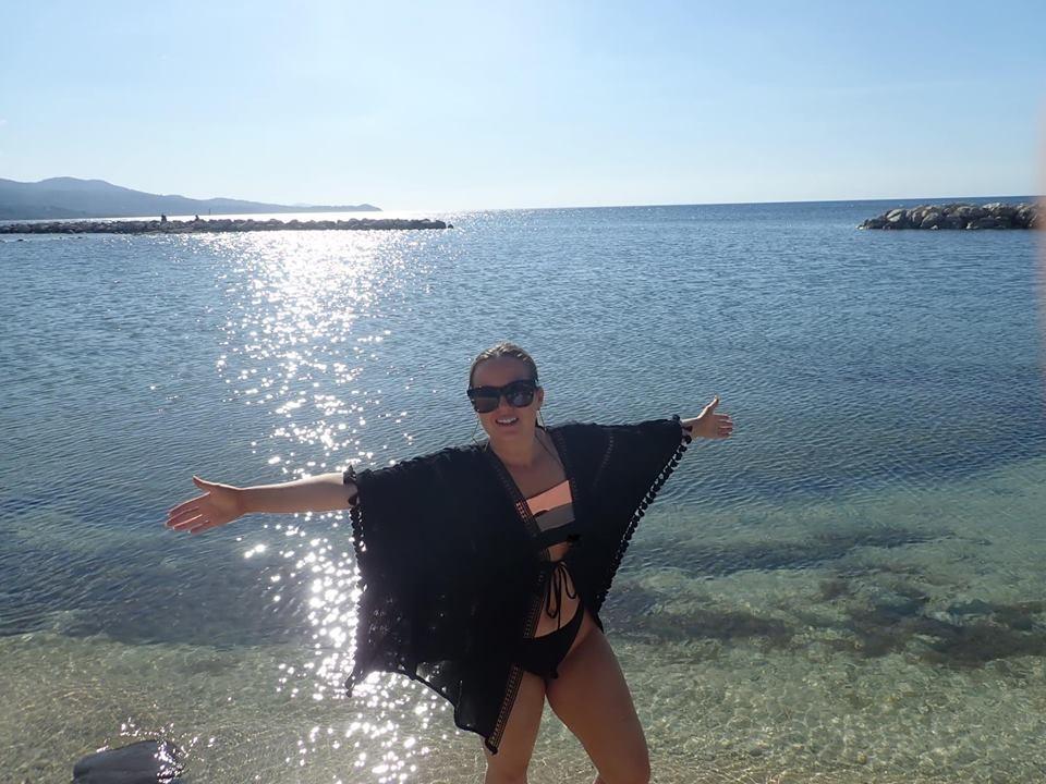 Woman posing on the beach in Montego Bay.| Montego Bay, Jamaica; Sunscape Splash Resort
