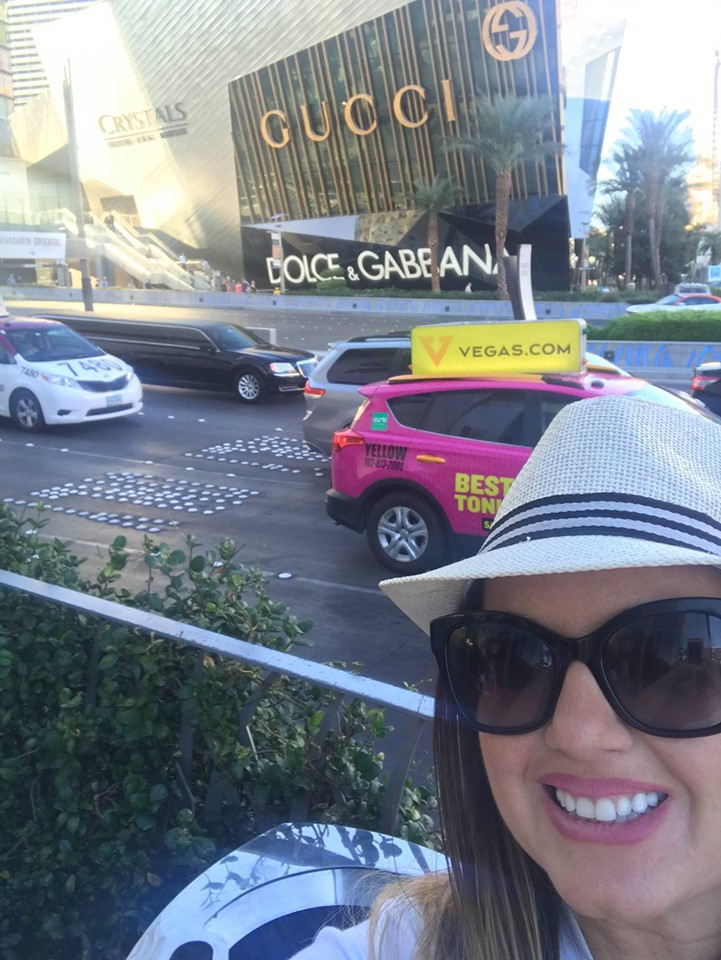 Woman taking a selfie with the Gucci store behind her in New Vegas.| Las Vegas- A Guide to Vegas