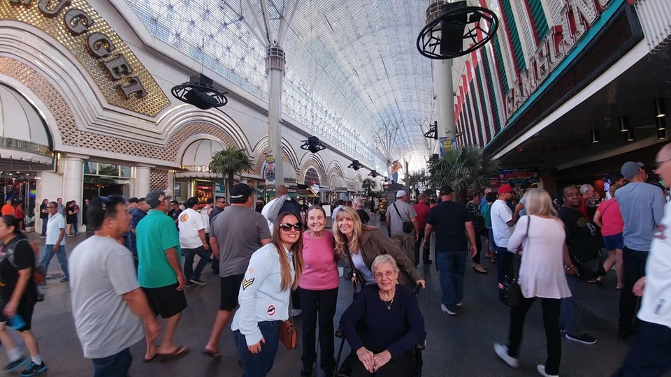 Women posing in the street with crowds behind them in Old Vegas. | Las Vegas- A Guide to Vegas