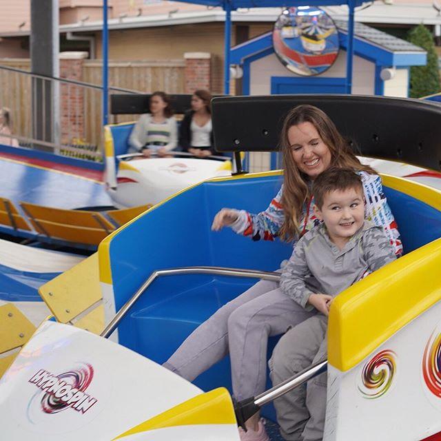 Mom with little boy on ride at the boardwalk. | Kemah Boardwalk in Texas