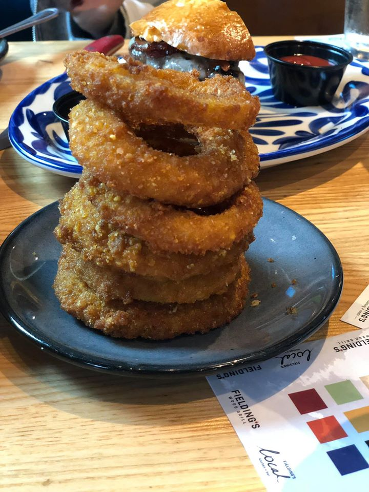 Plate of onion rings at Fielding Wood Grill.   Girls Weekend Getaway- Woodlands, TX