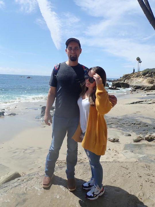 Couple posing on Laguna Beach.| 24 Hours in Orange County, CA