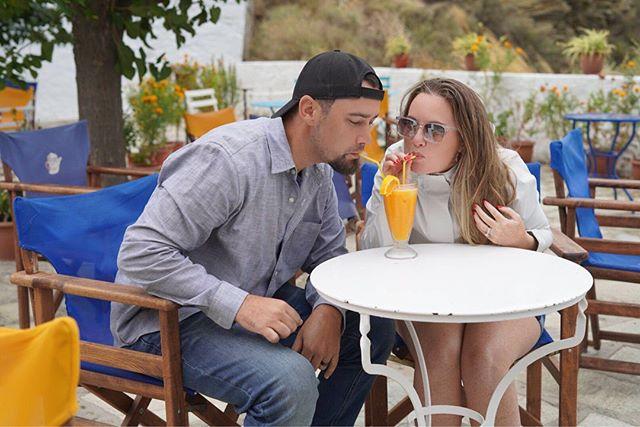 Couple at an outdoor table sharing a fresh orange juice in Greece.| Skopelos Island, Greece- Mamma Mia Island