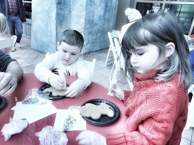 Kids decorating gingerbread men at the Gaylord Texan in Texas. | Christmas at the Gaylord Texan Hotel