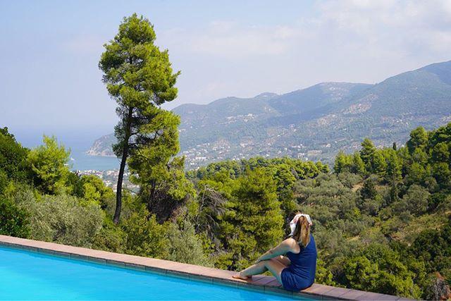 Woman sitting on the edge of the pool with a view of Skopelos Island. | Skopelos Island, Greece- Mamma Mia Island