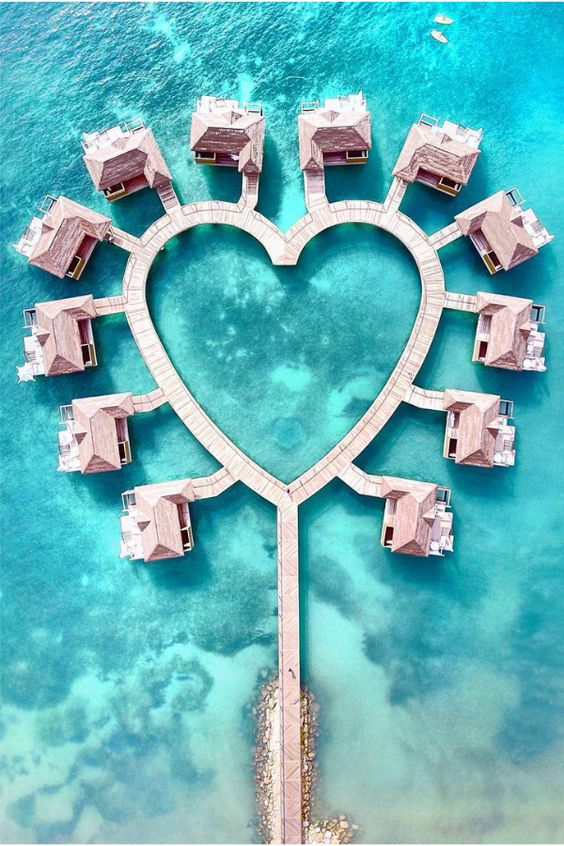Aerial view of heart-shaped Over Water Bungalows in Jamaica.   Jamaica Over-Water-Bungalows
