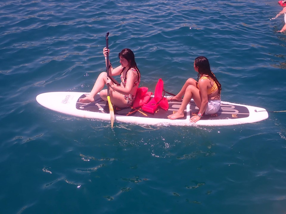 Two girls paddleboarding in Cabo.   Cabo, Mexico- The Best All Inclusive Vacation