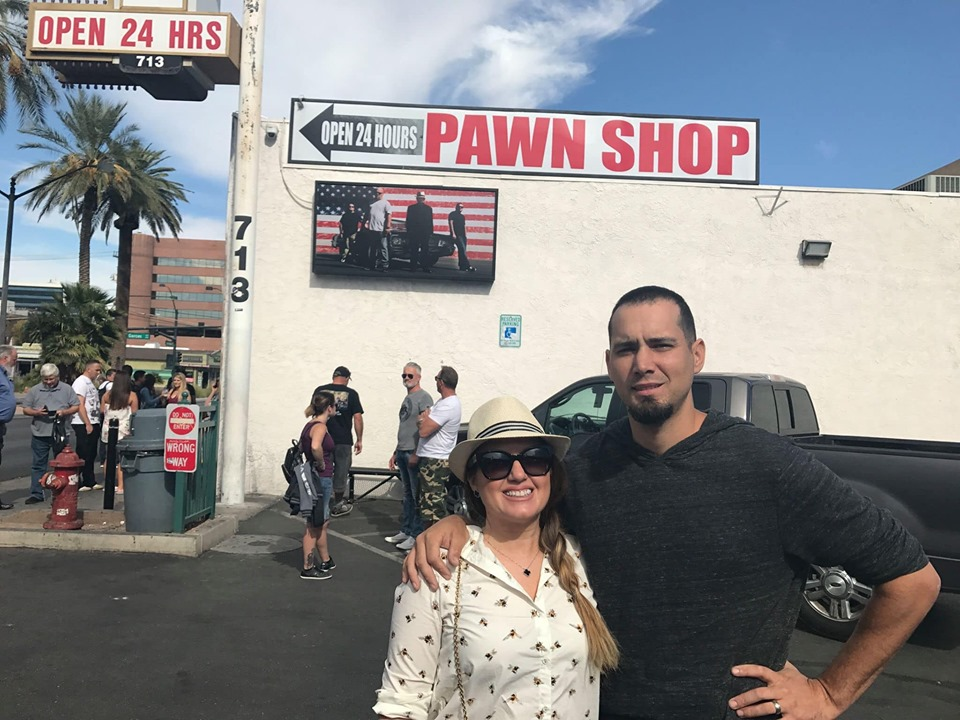 Couple posing in front of Pawn Shop sign for Pawn Stars Show. | Las Vegas- A Guide to Vegas