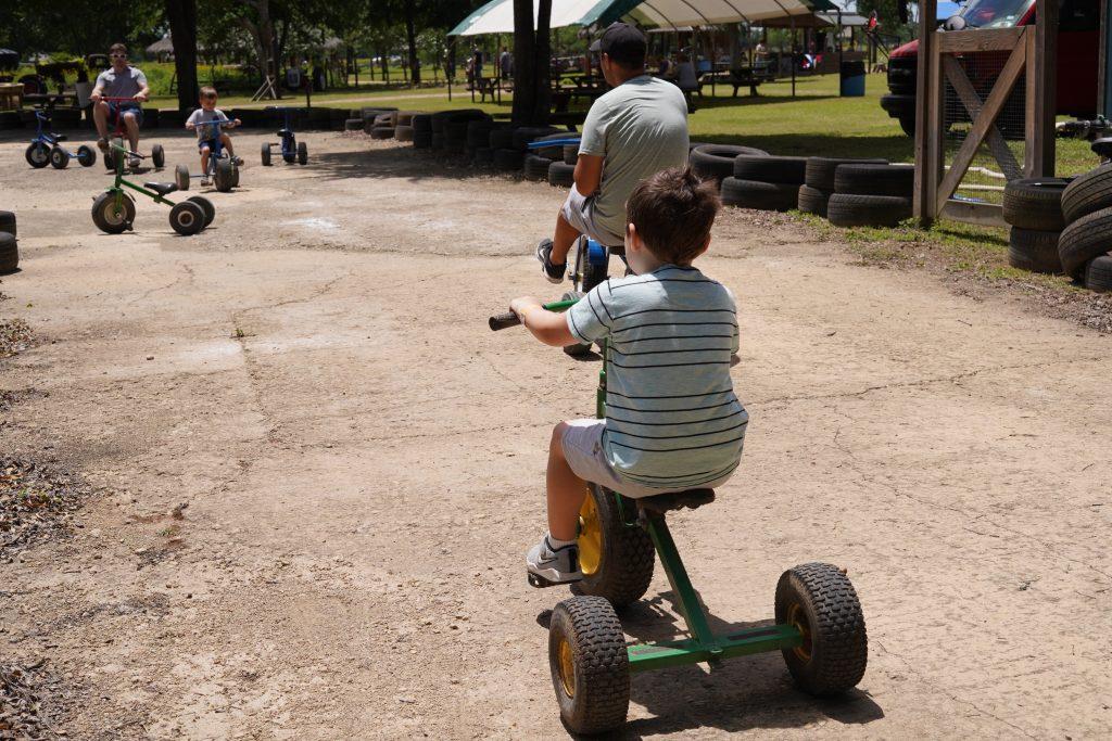 People riding peddle carts at Blessington Fields. | Blessington Farms in Simonton, Texas
