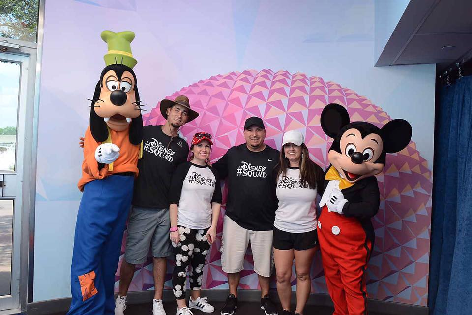 Two couples posing with Goofy and Mickey Mouse at Disney World.   Celebrating A Wedding Anniversary at Walt Disney World