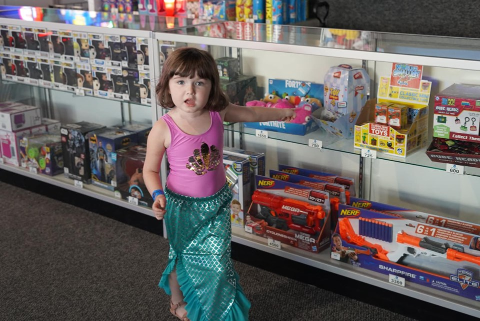 Little girl in the prize section of the arcade at Epic.| Epic Waterpark in Dallas, Texas