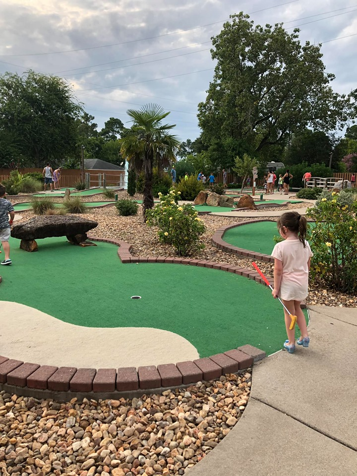 People play putt putt golf at Jellystone in Texas.   Jellystone Park in Waller, Texas