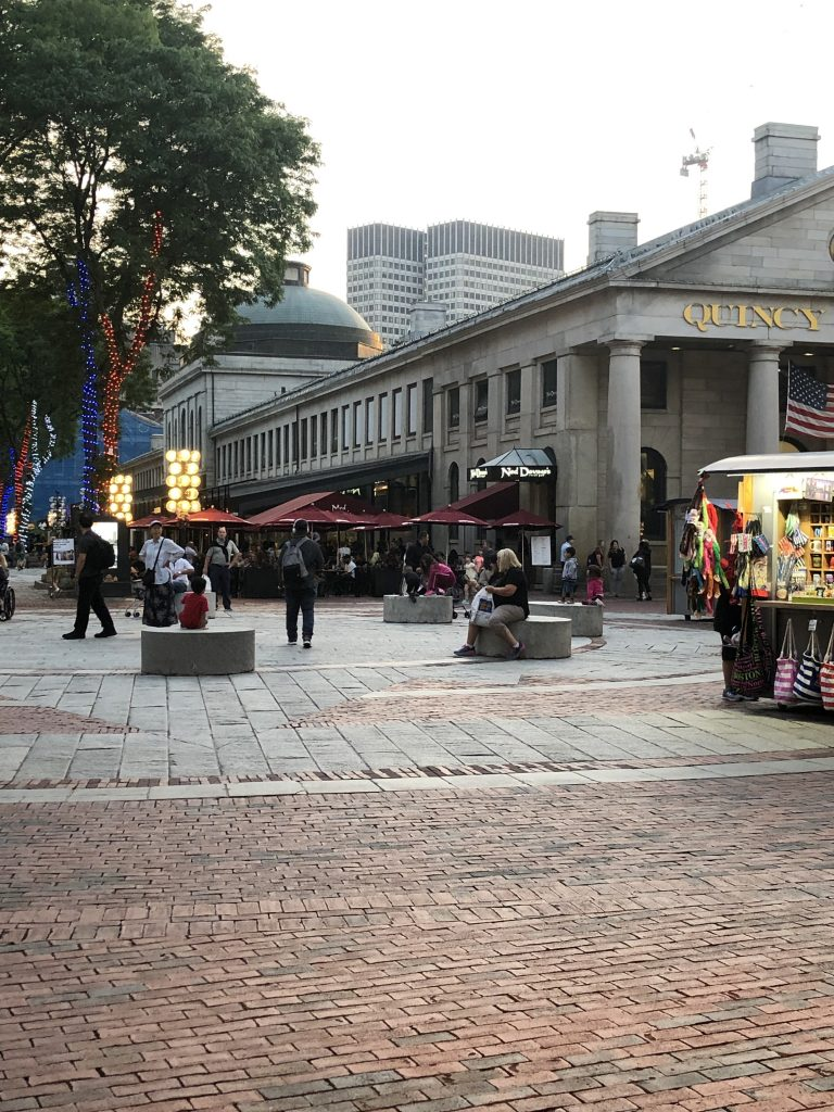 Crowds walking around outside Quincy Market in Boston. | Boston, Massachusetts- Adult Getaway