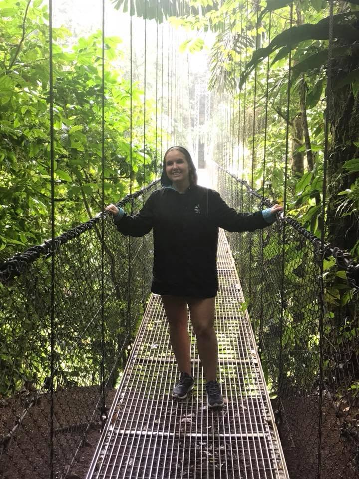Woman standing on the hanging bridges at La Fortuna Waterfall in Costa Rica.   Costa Rica, Arenal Volcano