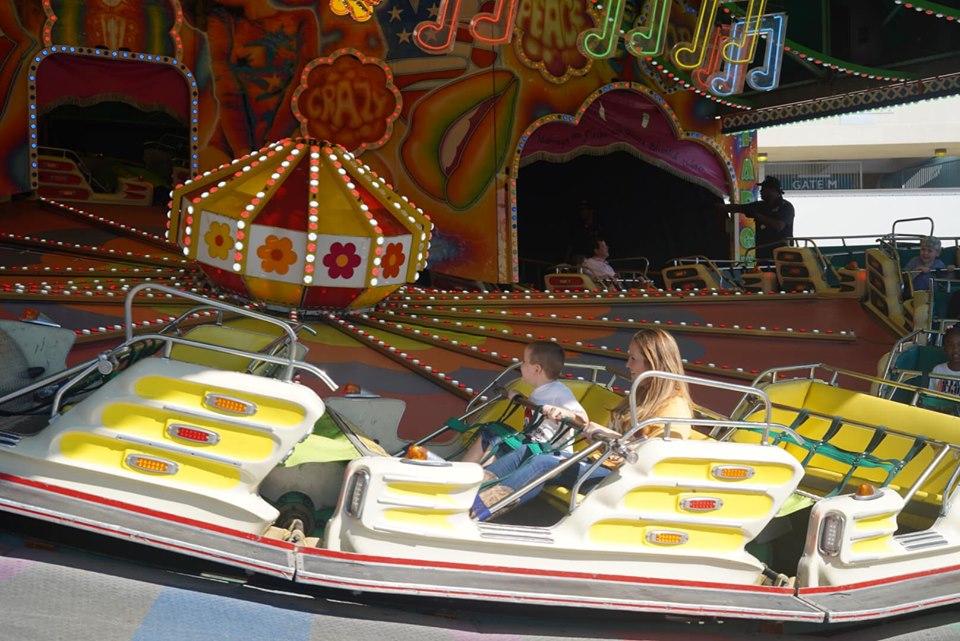 People riding rides at the fair. | State Fair of Texas-Dallas