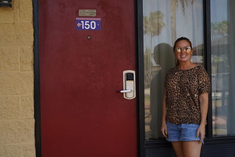 Woman posing in front of Room 150 at Knights Inn where Selena was shot in Corpus Christi.   Corpus Christi Bachelorette Weekend