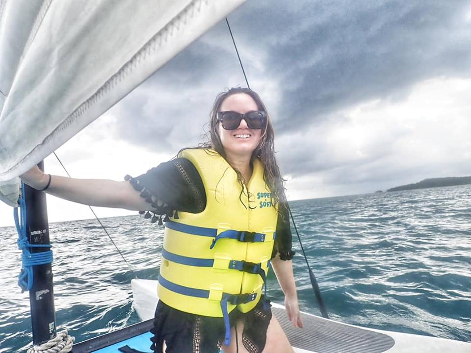 Woman on a sailboat in Jamaica.   Jamaica Over-Water-Bungalows