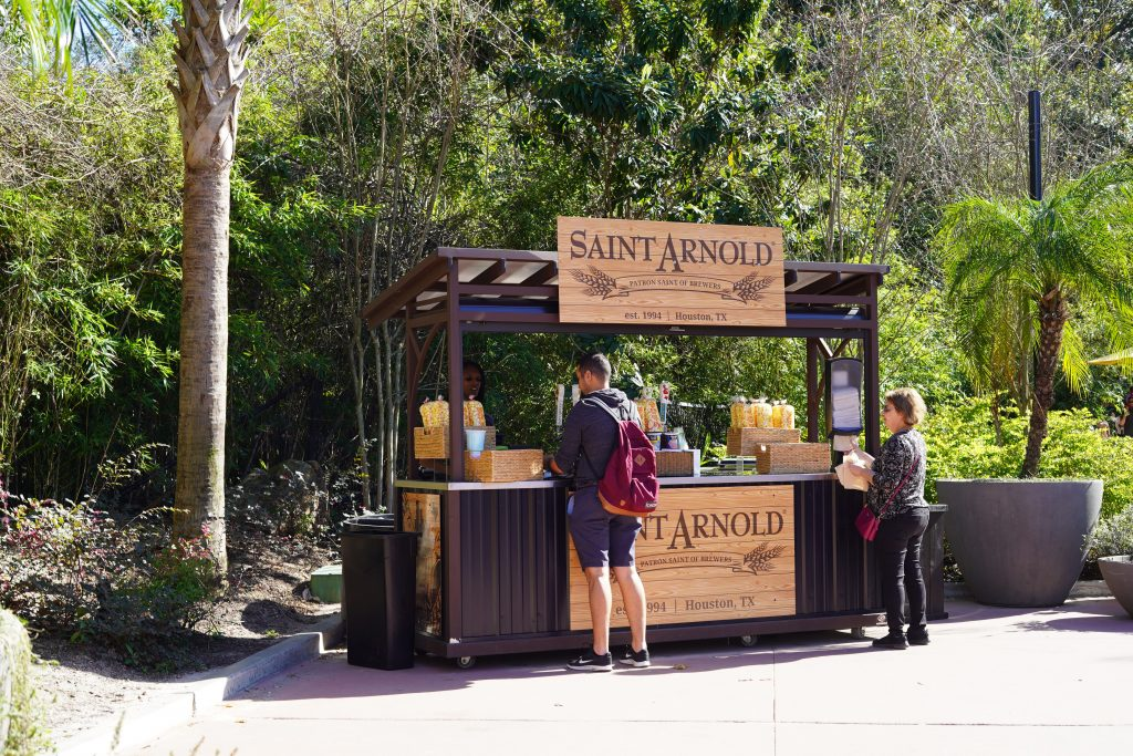 People buying food at the Saint Arnold Stand at the zoo. | The Houston Zoo