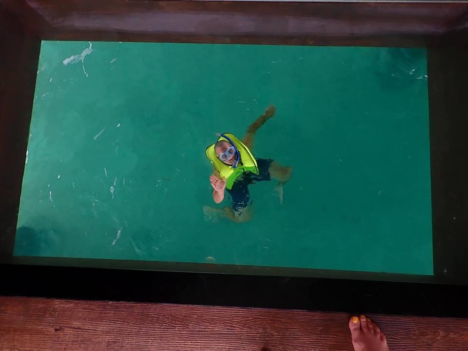 Man swimming at Sandals resort in Jamaica.   Jamaica Over-Water-Bungalows