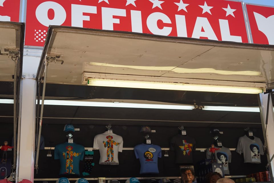 Storefront of souvenir shop t-shirts displayed at the fair. | State Fair of Texas-Dallas