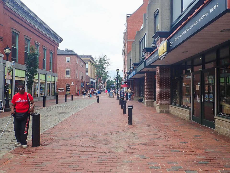 People walking down the street on a shopping center strip in Salem. | What to do in Salem, MA