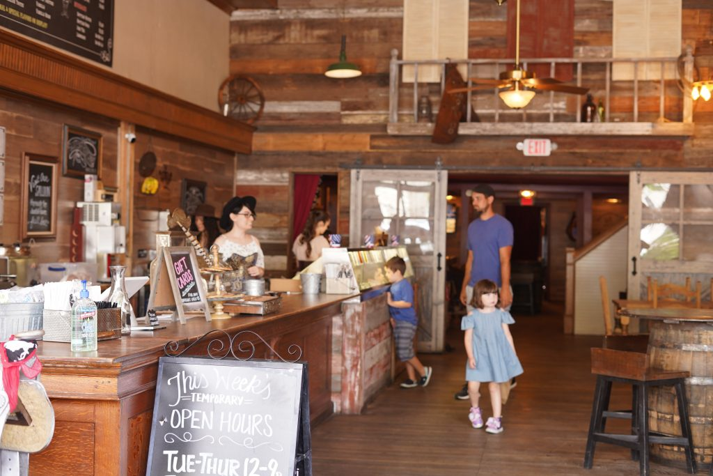 Man with kids at the cashier counter at Silversaddle Saloon.   A Guide to Granbury, Texas