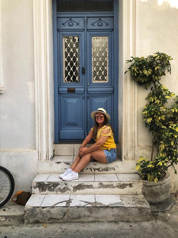 Woman posing in front of blue door on Skiathos Island.| Skopelos Island, Greece- Mamma Mia Island