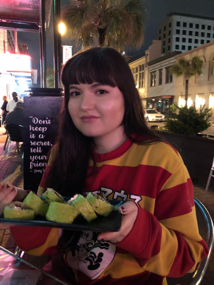 """Woman eating outside at Sky Bar Steak and Sushi in Galveston.   Adult Weekend in Galveston, Texas; on """"The Strand"""""""