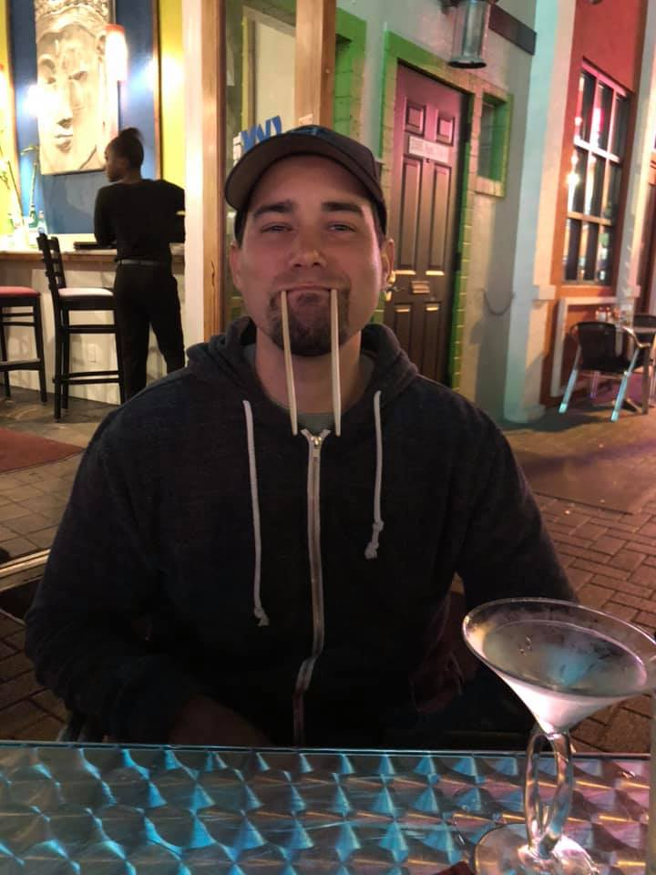 """Man eating outside at Sky Bar Steak and Sushi in Galveston.   Adult Weekend in Galveston, Texas; on """"The Strand"""""""