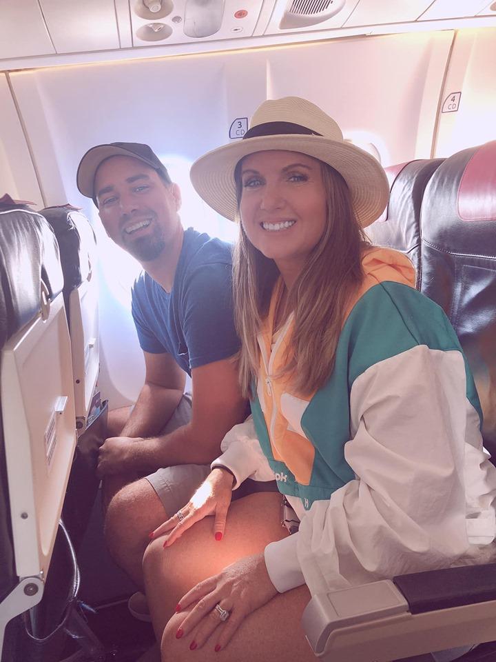 Couple posing on flight with Sky Express. | Skopelos Island, Greece- Mamma Mia Island