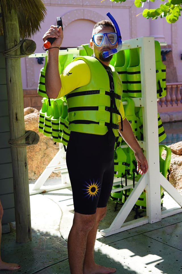 Man dressed in snorkeling gear at the Atlantis resort.   Atlantis, Bahamas