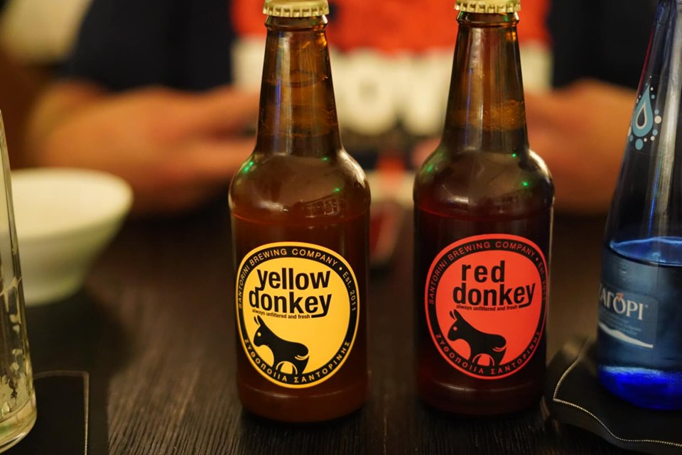 Yellow donkey and red donkey beers on a table at the restaurant at Sofitel Athens Airport Hotel. | Skopelos Island, Greece- Mamma Mia Island