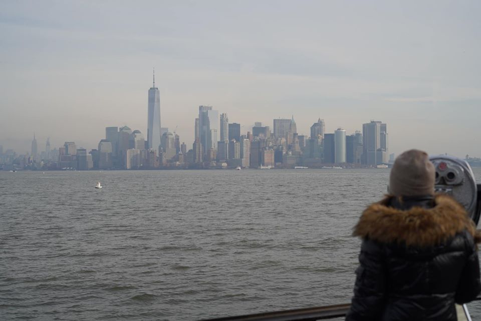 Woman enjoying the view while riding the Miss New York cruise ship for Statue of Liberty cruises.   New York City