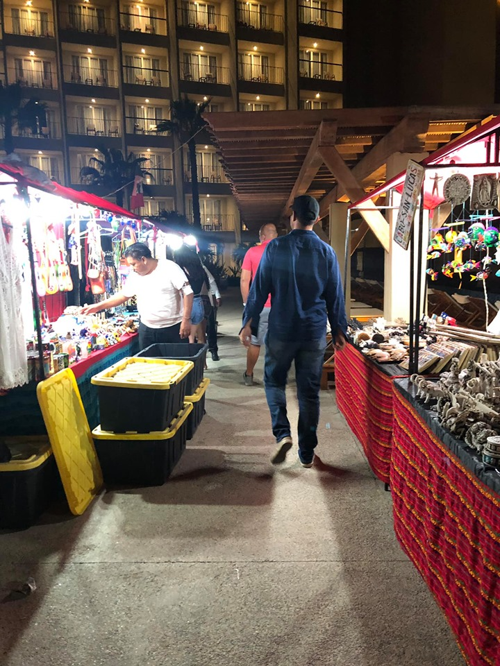 Man walking through street vendors at Reflect Krystal in Cabo.   Cabo, Mexico- The Best All Inclusive Vacation
