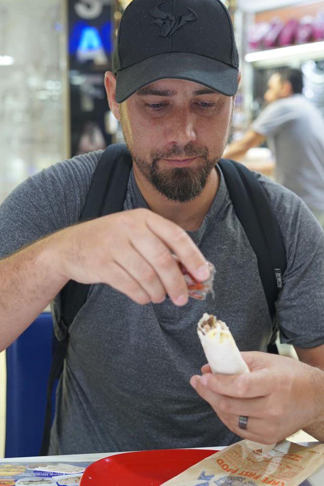 Man eating street vendor food inside Grand Bazaar. | Istanbul, Turkey