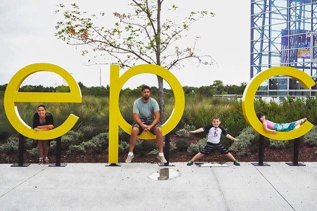 Family posing outside at the sign for Epic.| Epic Waterpark in Dallas, Texas