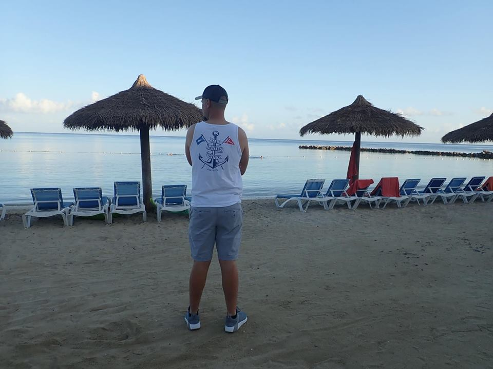 Man standing on the beach at the Sunscape Splash Resort in Montego Bay.| Montego Bay, Jamaica; Sunscape Splash Resort