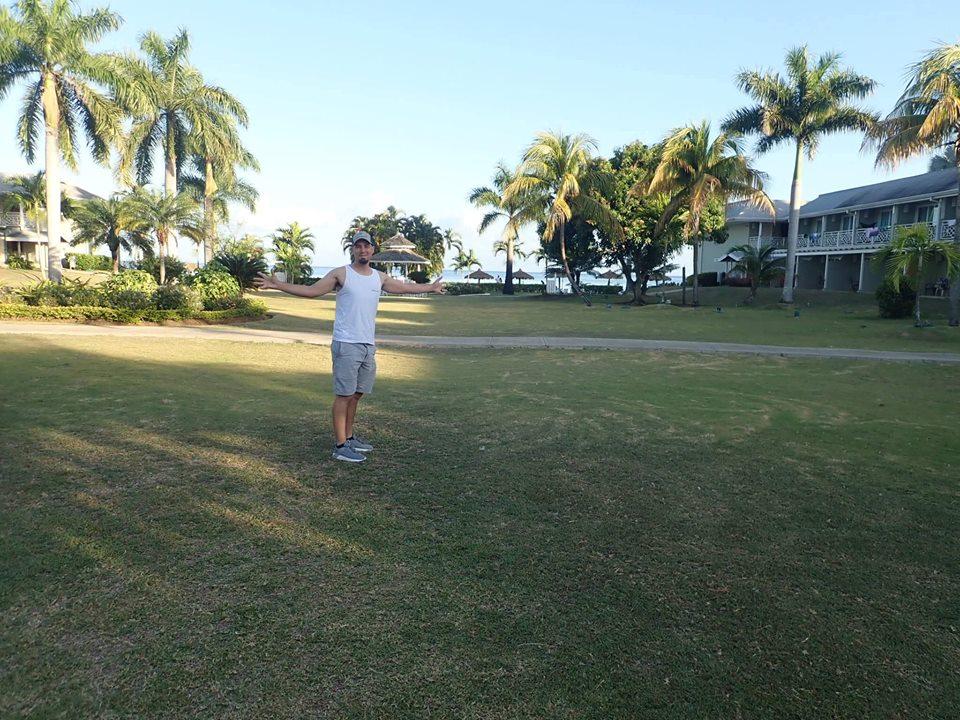 Man walking around the Cove grounds at the Sunscape Splash Resort in Montego Bay.| Montego Bay, Jamaica; Sunscape Splash Resort